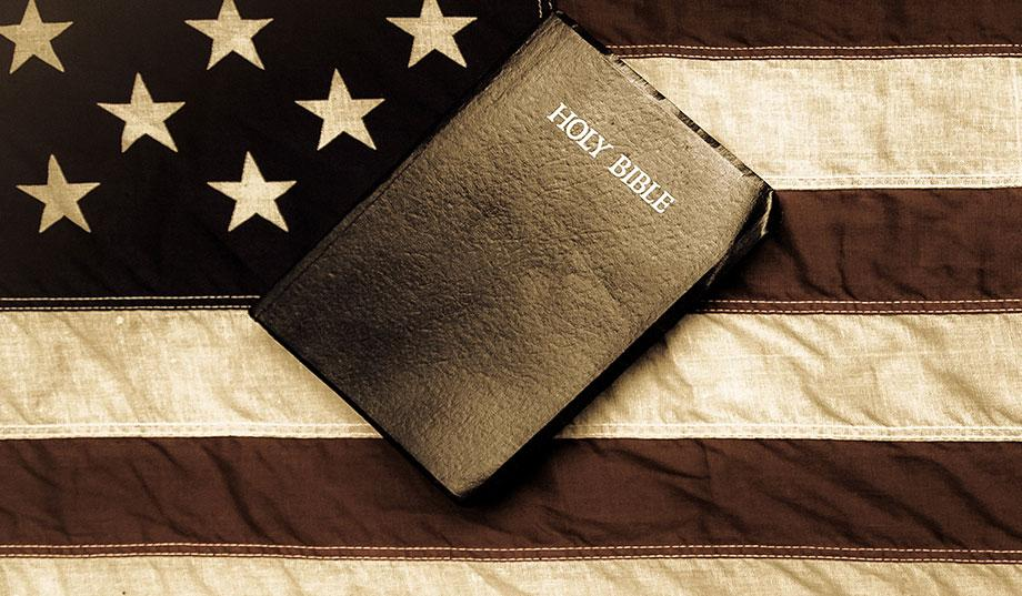 a picture of an American flag and a Bilble that challenges notions of religious freedom.