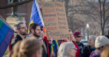 Marchers gather outside the courthouse in Decorah, IA during the 2018 women's march