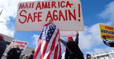 a crowd promoting the idea that foreign-born immigrants make America unsafe