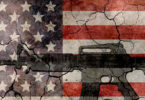 not the time for gun control. Image of an automatic rifle imposed over U.S. flag