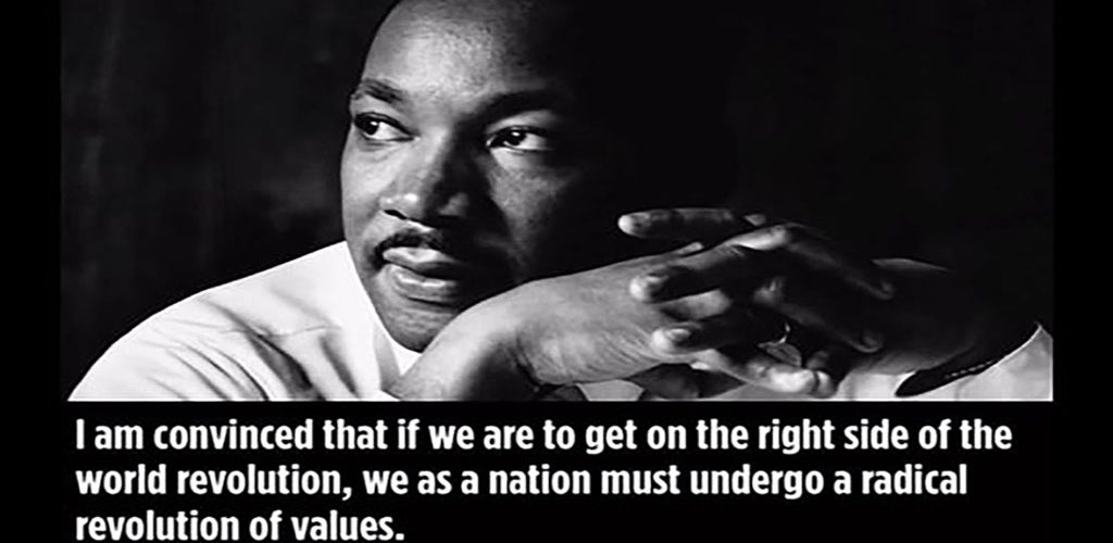 A picture of and quote from MLK advocating for a revolution